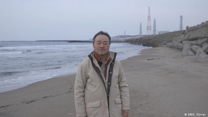 Kazuyuki Takemoto in front of the Kashiwazaki-Kariwa nuclear plant