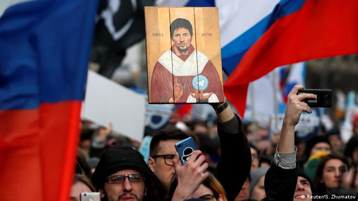 A man holds a picture of Pavel Durov, the founder of Telegram Messenger, during a rally to protest against tightening state control over internet