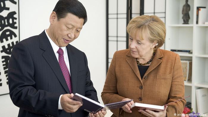 Merkel empfängt Xi Jinping (picture-alliance/dpa)
