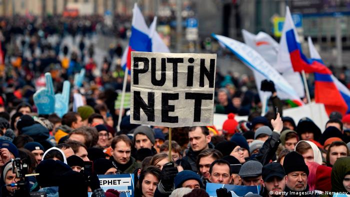 Protesters in Moscow holding sign saying Putin net