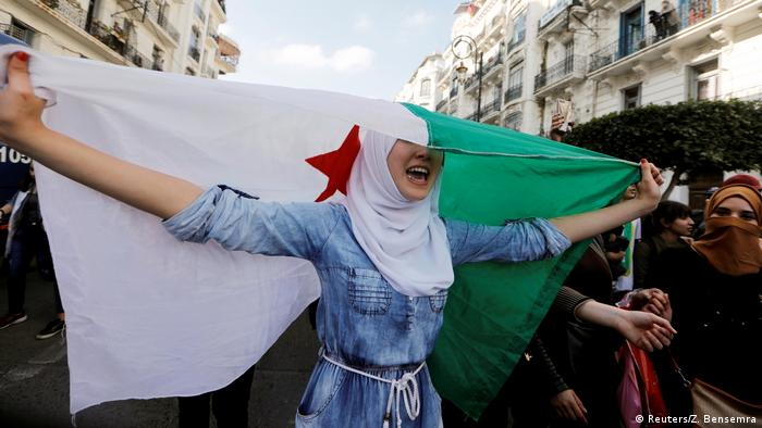 A student takes part in protests against President Abdelaziz Bouteflika in Algiers, Algeria
