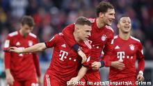 MUNICH, GERMANY - MARCH 09: Joshua Kimmich of Bayern Munich celebrates with teammate Leon Goretzka after scoring his team's fifth goal during the Bundesliga match between FC Bayern Muenchen and VfL Wolfsburg at Allianz Arena on March 09, 2019 in Munich, Germany. (Photo by Alex Grimm/Bongarts/Getty Images)