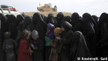 Women stand in line to receive aid near Baghouz, Deir Al Zor province, Syria March 5, 2019. REUTERS/Rodi Said