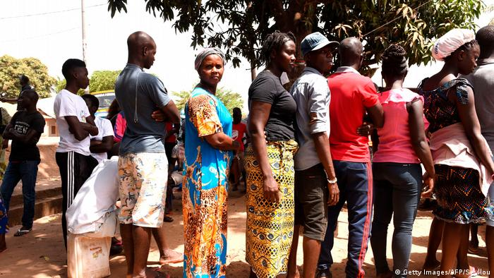 Voters in Guinea-Bissau line up outside, ready to vote in the 2019 parliamentary election