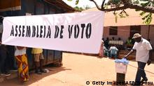 A man casts his vote at a polling station in Bissau on March 10, 2019, during the legislative elections. (Photo by SEYLLOU / AFP) (Photo credit should read SEYLLOU/AFP/Getty Images)