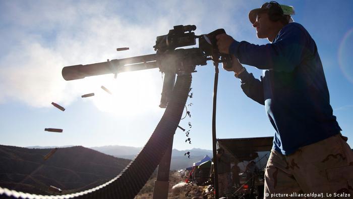 Dave Lansky fires a Minigun, which shoots 50 rounds a second, at the Big Sandy Machine Gun Shoot outside Wikieup, Arizona