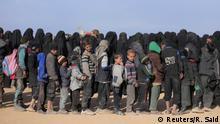 Boys stand in line to receive aid near Baghouz, Deir Al Zor province, Syria March 5, 2019. REUTERS/ Rodi Said