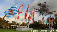 states' flags mounted outside a conference building