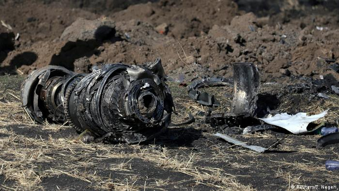 Engine parts are seen at the scene of the Ethiopian Airlines Flight ET 302 plane crash, near the town of Bishoftu, southeast of Addis Ababa, Ethiopia