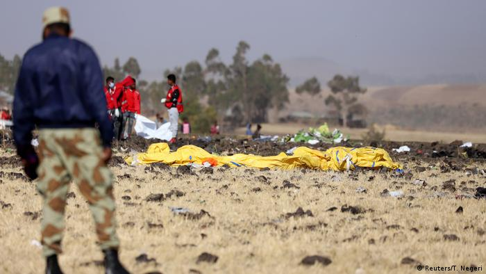 Members of the search and rescue mission look for dead bodies of passengers at the scene of the Ethiopian Airlines Flight ET 302