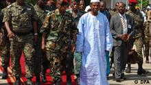 A photograph made available 30 September 2009 shows Guinea Junta head Captain Moussa Dadis Camara (C- L) walks with the Prime Minister Kabine Komara (C-R) in Conakry, Guinea 03 March 2009. Human rights groups claim more than 100 people were killed when Guinean troops opened fire on opposition protesters on Monday 28 September 2009. Around 50 000 people were protesting over rumours that Captain Camara intends to run for president in an election scheduled for next January. EPA/STR +++(c) dpa - Report+++