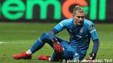 Besiktas' German goalkeeper Loris Karius pictured sat on the ground