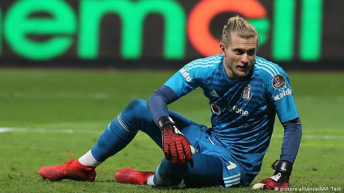 Besiktas' German goalkeeper Loris Karius pictured sat on the ground