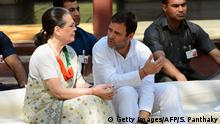 12.03.2019 *** Rahul Gandhi (C), president of the Indian opposition Congress party, talks with his mother the Congress chairperson Sonia Gandhi (L) as they visit the Gandhi Ashram in Ahmedabad on March 12, 2019. (Photo by SAM PANTHAKY / AFP) (Photo credit should read SAM PANTHAKY/AFP/Getty Images)