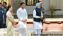 12.03.2019 *** Rahul Gandhi (L), president of the Indian opposition Congress party, Congress chairperson Sonia Gandhi (L) and former Indian prime minister Manmohan Singh (C) attend a prayer meeting as they visit the Gandhi Ashram in Ahmedabad on March 12, 2019. (Photo by SAM PANTHAKY / AFP) (Photo credit should read SAM PANTHAKY/AFP/Getty Images)