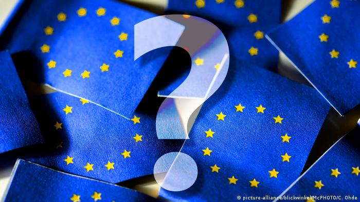 A question mark superimposed on an image of EU flags