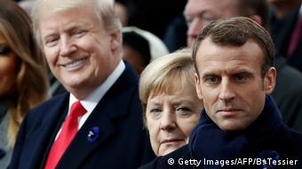 Trump, Merkel and Macron stand in a row (Getty Images/AFP/B. Tessier)