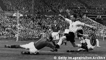 5 May 1956: FA Cup Final, Birmingham City v Manchester City, Wembley. Manchester's goalkeeper Bert Trautmann dives at the feet of Birmingham's Murphy during the match. It was whilst making this save that Trautmann unknowingly broke his neck. MandatoryCredit: Allsport Hulton/Archive