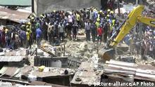 13.03.2019 *** In this image taken from video rescue workers and emergency teams work at the scene of a building collapse in Lagos, Nigeria, Wednesday March 13, 2019. There was no immediate official word on numbers of casualties. (AP Photo) |