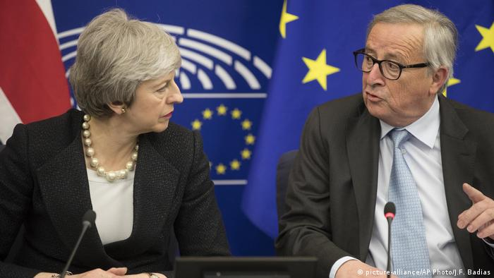 Britain's Prime Minister Theresa May, left, and European Commission President Jean-Claude Juncker attend a media conference at the European Parliament in Strasbourg