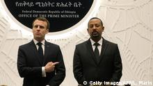 12.03.2019 Ethiopian Prime Minister Abiy Ahmed (R) speaks with French President Emmanuel Macron (L) after signing agreements during a meeting on March 12, 2019 in Addis Ababa. (Photo by Ludovic MARIN / POOL / AFP) (Photo credit should read LUDOVIC MARIN/AFP/Getty Images)
