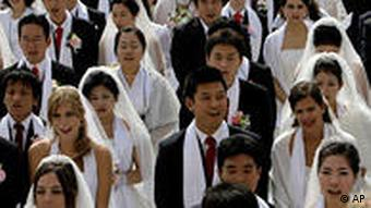 Couples from around the world participate in a mass wedding ceremony in Asan