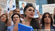 Director of Turkish newspaper Ozgur Gundem, Eren Keskin (C), speaks to the press as Kurdish women hold pictures of jailed journalists in Istanbul on September 10, 2012, during the start of the trial of 44 journalists with suspected links to rebels from the Kurdistan Workers' Party (PKK), in the latest of a series of legal operations against the Kurdish militants. Some 44 suspects, 36 of them arrested pending trial, are currently facing charges in the 800-page indictment that was unanimously accepted by the court in May 2012. The suspects are charged with leading a terrorist organization, being a member of a terrorist organization, and being a member of the press committee of a terrorist organization. AFP PHOTO / BULENT KILIC (Photo credit should read BULENT KILIC/AFP/GettyImages)