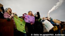 TOPSHOT - Students and pupils demonstrate as part of the Fridays for Future protest with banners, on January 25, 2019 in front of the Economy Ministry in Berlin where the members of the coal commission meet. - The so-called Kohlekommission (coal commission), a governmental commission for growth, structural change and employment is to announce a roadmap for exiting coal as part of efforts to make Germany carbon-neutral by 2050. (Photo by Odd ANDERSEN / AFP) (Photo credit should read ODD ANDERSEN/AFP/Getty Images)