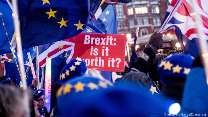 Pro-remain protesters rally outside parliament in London on 12 March 2019