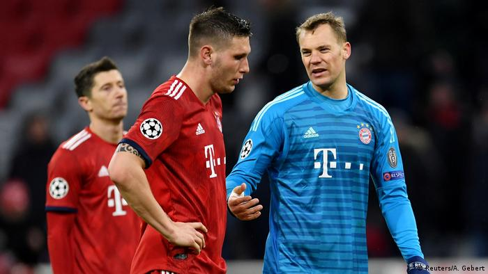 Manuel Neuer compares notes with Niklas Süle at the end of the gam