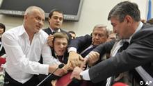 The deputies of the political bloc of Vitali Klitschko clash with the pro-mayor majority during a Kiev city council session, Ukraine, Tuesday, Oct. 13, 2009. World heavyweight boxing champion Vitali Klitschko deployed his size and weight in Ukrainian local politics Tuesday, leading a move to block what he called illegal operations of the Kiev City council. Klitschko - the holder of belts from the International Boxing Federation, the World Boxing Organization and the International Boxing Organization - was at the head of a group of some 15 opposition council members preventing the work of the City Council, physically blocking the majority of members from calling a Council meeting to order. (AP Photo/Pavel Terkhov/Pool)