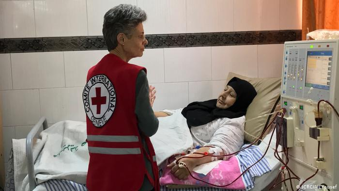 Marianne Gasser visits a patient at the Al Tal hospital in Damascus