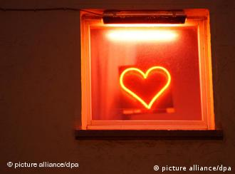 A red light shaped as a heart outside a brothel in Frankfurt