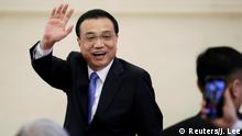Chinese Premier Li Keqiang waves as he leaves at the end of a news conference following the closing session of the National People's Congress (NPC) at the Great Hall of the People in Beijing, China March 15, 2019. REUTERS/Jason Lee