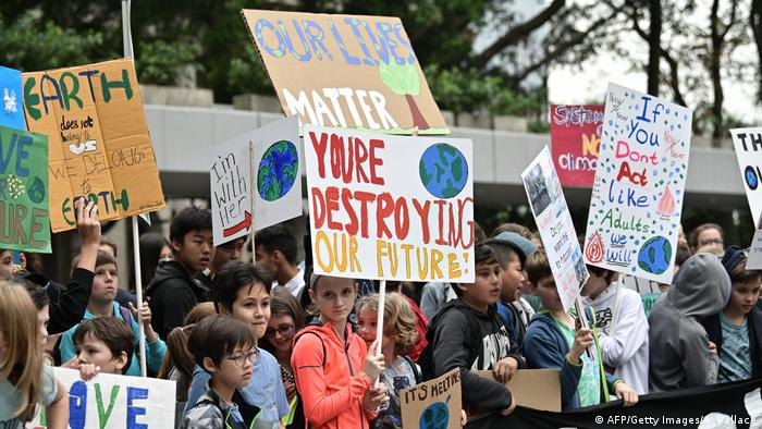 Students take part in a protest against climate change in Hong Kong on March 15, 2019, as part of a global movement called #FridaysForFuture.