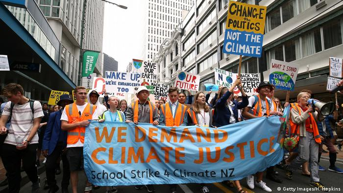 Students march through the streets during a strike to raise climate change awareness on March 15, 2019 in Wellington, New Zealand.