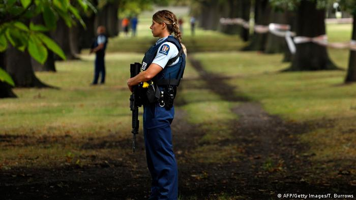 Police stand guard outside the Al Noor Mosque in Christchurch, New Zealand