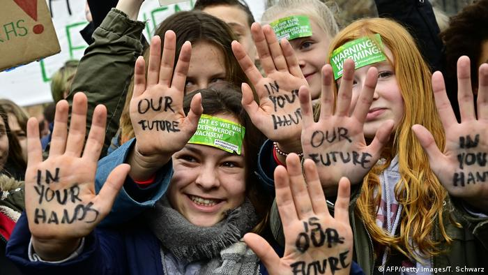 Youths show their hands bearing the inscriptions Our future in your hands during the Fridays For Future movement in Berlin