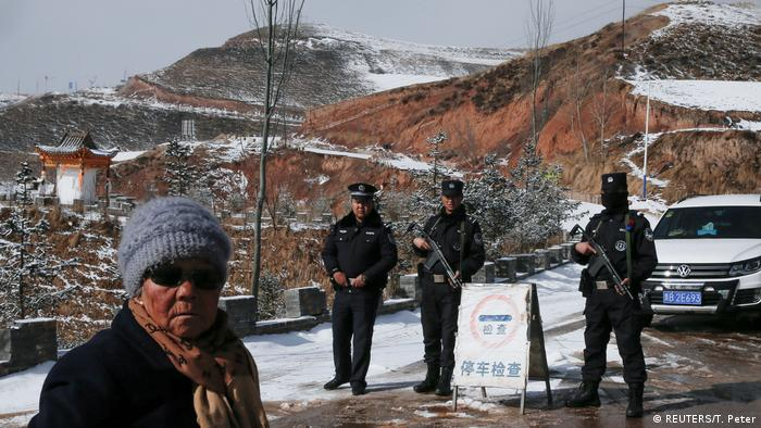 Armed officers stand near the birthplace of the Dalai Lama