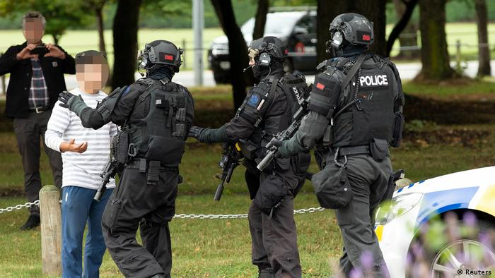 AOS (Armed Offenders Squad) push back members of the public following a shooting at the Masjid Al Noor mosque in Christchurch,