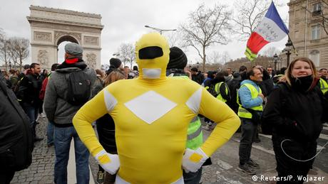 A protester wearing a yellow costume attends a demonstration (Reuters/P. Wojazer)