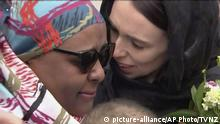 In this image made from video, New Zealand's Prime Minister Jacinda Ardern, right, hugs and consoles a woman as she visited Kilbirnie Mosque to lay flowers among tributes to Christchurch attack victims, in Wellington, Sunday, March 17, 2019. (TVNZ via AP) |