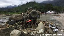 Wreckage of vehicle in Sentani (Getty Images/AFP/N. Somba)