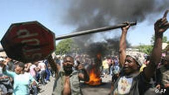 Residents from the Sakhile Township near Standerton, east of Johannesburg, South Africa, protest against their poor living conditions
