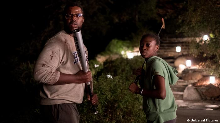Film still from 'Us' - Man with baseball bat and girl with golf club (Universal Pictures)