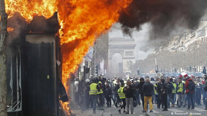 Protesters set a store on fire during yellow vest protests in Paris