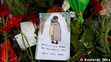 Flowers and signs are pictured at a memorial as a tribute to victims of the mosque attacks, near a police line outside Masjid Al Noor in Christchurch, New Zealand, March 17, 2019. REUTERS/Jorge Silva TPX IMAGES OF THE DAY