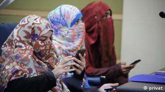 Women on smartphones in Pakistan