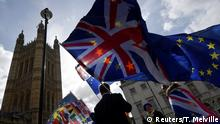 Anti-Brexit protesters gather opposite the Houses of Parliament, in London, Britain, March 18, 2019. REUTERS/Toby Melville