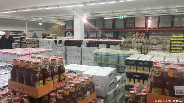 Bottles of sauce and boxes stacked high